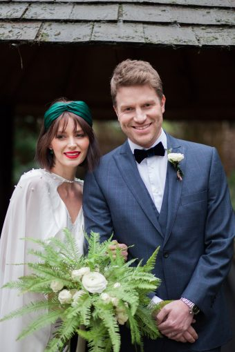 modern bridal couple with greenery bouquet
