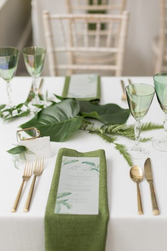 botanical green place setting with gold cutlery