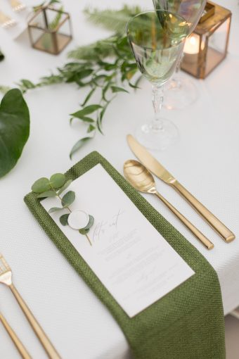 green & gold wedding place setting