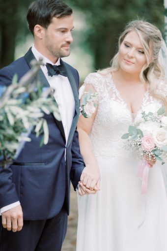 classically style bride and groom at wedding in france with blush bouquet