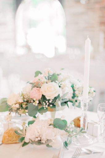romantic blush wedding tablescape with olive foliage