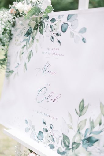 wedding welcome sign with illustrated green folilage leaves