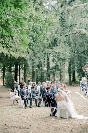 guests at romantic outdoor brittany wedding ceremony