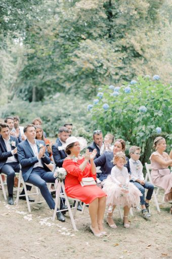 wedding guests at romantic outdoor brittany wedding ceremony