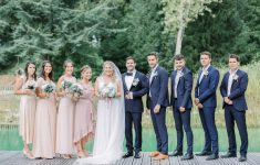 blush bridesmaids dresses, bride wearing veil and groomsmen in black tie wedding in france