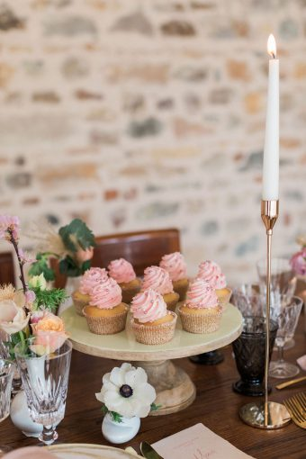 pink iced cupcakes for a rustic french wedding