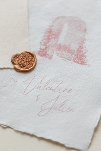 pink wedding calligraphy invites with bronze wax seal