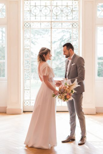 bride and groom first look at rustic fine art french wedding