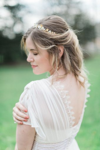 bride in french lace wedding dress with half-up hair and delicate gold and pearl crown