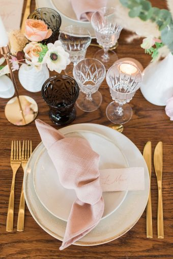 rustic french place setting with blush knotted napkins and gold cutlery