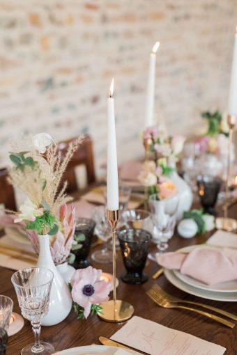 rustic french wedding table with blush knotted napkins and gold cutlery