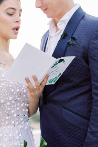 bride and groom with programme