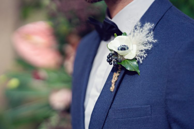 anemone boutonniere for grooms